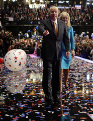 U.S. Republican presidential nominee Senator McCain with his wife points into crowd at Republican National Convention in Minneapolis