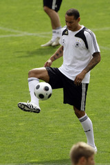 Jones plays with the ball during a training session of the German national soccer team in Palma de Mallorca