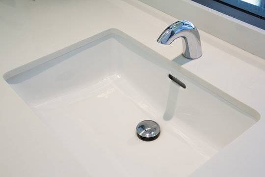 automatic faucet in bathroom