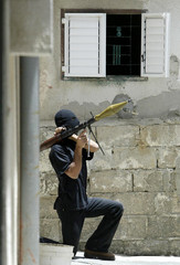A member of the Fatah force takes up position with a rocket propelled grenade during clashes with Hamas militants in Gaza Strip
