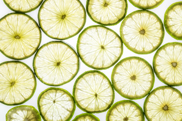 Bright citrus lime slices on white