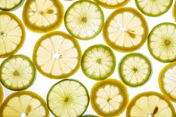 Bright citrus lime and lemon slices on white
