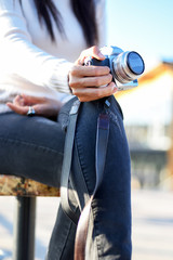 Closeup photographer holding camera, close-up, Selective focus.
