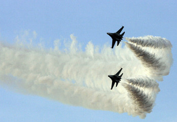 Two Russian Sukhoi-30 jets perform during a military parade to celebrate the anniversary of the Venezuelan Air Force in Macaray