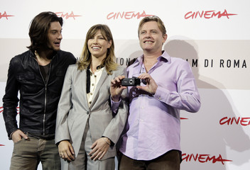 Director Elliot takes a photo as he poses with actor Barnes and actress Biel during photo call at Rome Film Festival