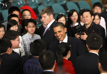 U.S. President Obama greets participants at a town hall-style meeting in Shanghai