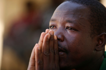 Bubacar Samba, a Gambian migrant who voluntarily returned from Libya, reacts during an interview at his home in Brikama, Gambia