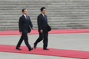 Visiting Russian President Medvedev walks with Chinese President Hu Jintao in Beijing