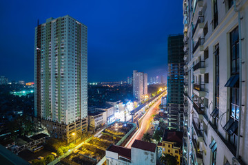 Aerial view skyline, building, and under construction sky train/metro project at blue hour in Tu Liem district, Hanoi. The first metro line opening in 2018, expected to transport 200K passengers daily