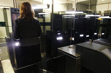 A Home Office worker demonstrates the use of new facial recognition gates at the North Terminal of Gatwick Airport near London