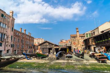 shipyard building and repairing gondolas in venice