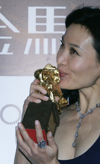 """Actress Joan Chen kisses trophy after winning Best Leading Actress for """"The Home Song Stories"""" at 44th Golden Horse Awards in Taipei"""