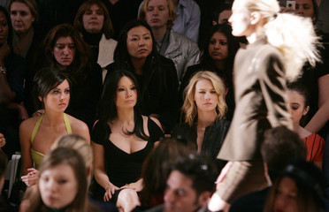 Actress Lucy Liu sits on the front row for the Herve Leger collection at Fashion Week in New York