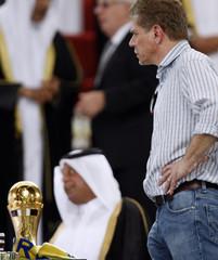 Al-Rayyan's head coach Paulo Autuori of Brazil looks on near the trophy after Al-Gharafa won the final match at Qatar's Emir Cup in Doha