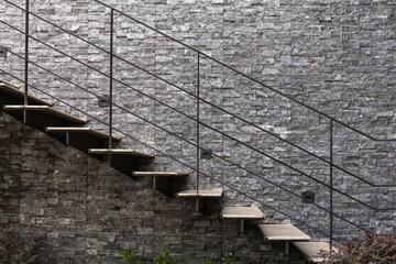 Foto op Plexiglas Trappen Marble stairs with metal handrail on granite wall