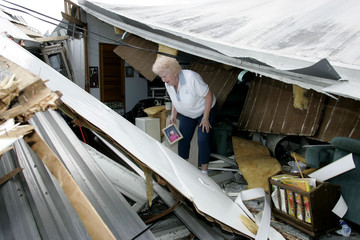 Joan Clay saves family photos after Hurricane Jeanne hit her home.