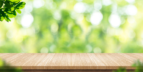 Empty wood plank table top with blur park green nature background bokeh light,Mock up for display or montage of product,Banner or header for advertise on social media,Spring and Summer concept Wall mural