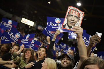 A magazine cover featuring U.S. Senator Barack Obama is shown among banners at a rally at Chicago