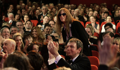 U.S. musician Patti Smith stands up after being introduced  during the opening ceremony of the 58th Berlinale International Film Festival in Berlin