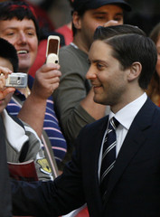 "Fans take pictures with their mobile phones as U.S. actor Tobey Maguire arrives for the German premiere of ""Spider-Man 3"" in Berlin"
