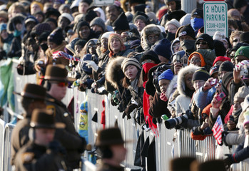 Crowds of spectators line the inaugural parade route for U.S. President Barack Obama in Washington