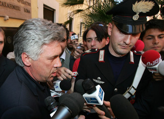 AC Milan's coach Ancelotti leaves the Italian Carabinieri police headquarters after being questioned by Naples' prosecutors in Rome