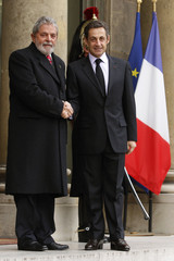 France's President Nicolas Sarkozy welcomes Brazil's President Luiz Inacio Lula da Silva at the Elysee Palace in Paris