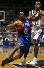 New York Knicks guard Jermaine Jackson fouled Milwaukee Bucks guard Michael Redd.