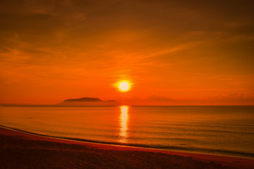 Landscapes of sunset on the beach with colorful sky background.