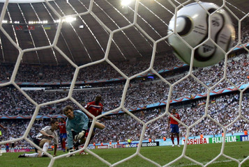 Costa Rica's Paulo Wanchope (C) scores his second goal against Germany during their Group A World Cu..