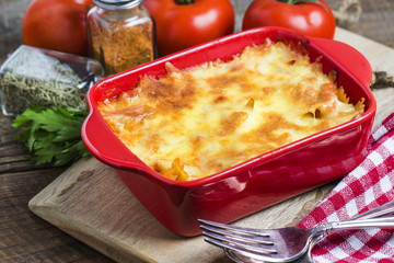 Bacon lovers' mac and cheese in baking dish Cheese face