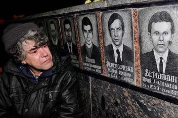 Ukrainian man looks at a memorial dedicated to firemen who died after the Chernobyl nuclear ...