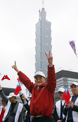 TAIWAN PRESIDENTIAL CANDIDATE LIEN CHAN MAKES THE VICTORY SYMBOL IN TAIPEI.