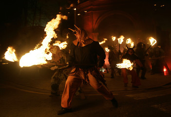 "Performers hold torches as they take part in ""Correfoc"" party in Palma de Mallorca"