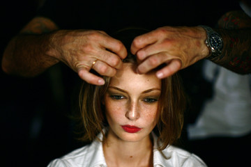 A model has her hair done backstage at the Charlotte Ronson Spring 2009 collection during New York Fashion Week