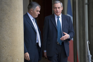 Bank of France Governor Noyer and Patrick Werner, CEO of French bank La Banque Postale, leave the Elysee Palace after a meeting with France's PresidentSarkozy in Paris