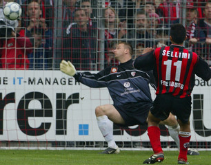 SELLIMI OF SC FREIBURG SCORES A GOAL AGAINST FIRST FC KAISERSLAUTERNGOALIE GEORG KOCH IN FREIBURG.