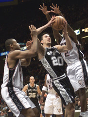 SPURS GINOBILI DRIVES TO BASKET AGAINST NETS DURING FIRST QUARTER OFNBA PLAY.