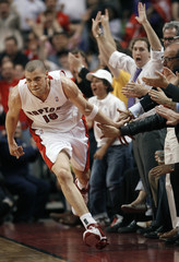 Toronto Raptors' Parker runs past fans during their first round NBA Eastern Conference playoff basketball game in Toronto