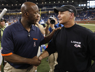 Chicago Bears head coach Lovie Smith and Detroit Lions head coach Rod Marinelli greet each other after their NFL football game in Detroit
