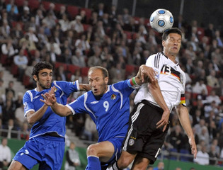 Germany's Ballack fights for the ball with Azerbaijan's Javadov and Abbasov during their 2010 World Cup qualifying soccer match in Hanover