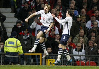 Tottenham Hotspur's Pavlyuchenko celebrates with Bale after scoring during their English FA Cup soccer match against Manchester United in Manchester