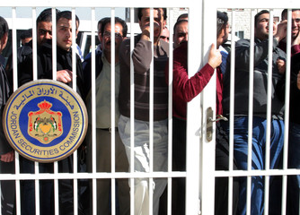 Dozens of small investors protest outside the Jordanian Securities Commission in Amman