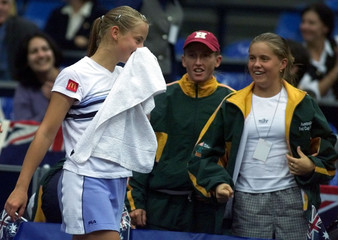 DOKIC OF AUSTRALIA CONGRATULATED BY HER TEAMMATES.