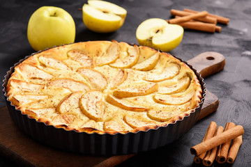 Homemade cheese pie with apples and cinnamon.