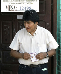 Bolivian President Evo Morales walks to deposit his ballot as he votes in Villa 14 de Septiembre