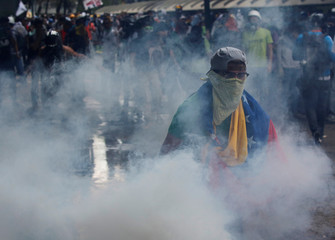 Opposition supporters clash with security forces during a protest against President Nicolas Maduro in Caracas