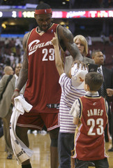 Cavaliers forward James greets some children after the fourth quarter of NBA basketball action in Philadelphia