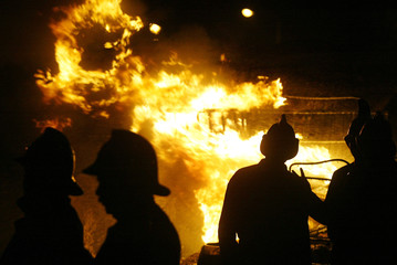 FIRE FIGHTERS TRY TO EXTINGUISH A BLAZE FROM A PETROL TANKER IN BOMBAY.