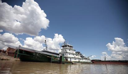 Boats remain anchored at the edge of the Paraguay River near Asuncion